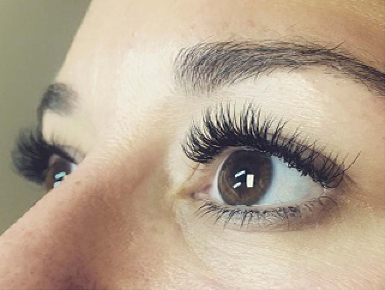 close up view of woman's eyes with lash extensions