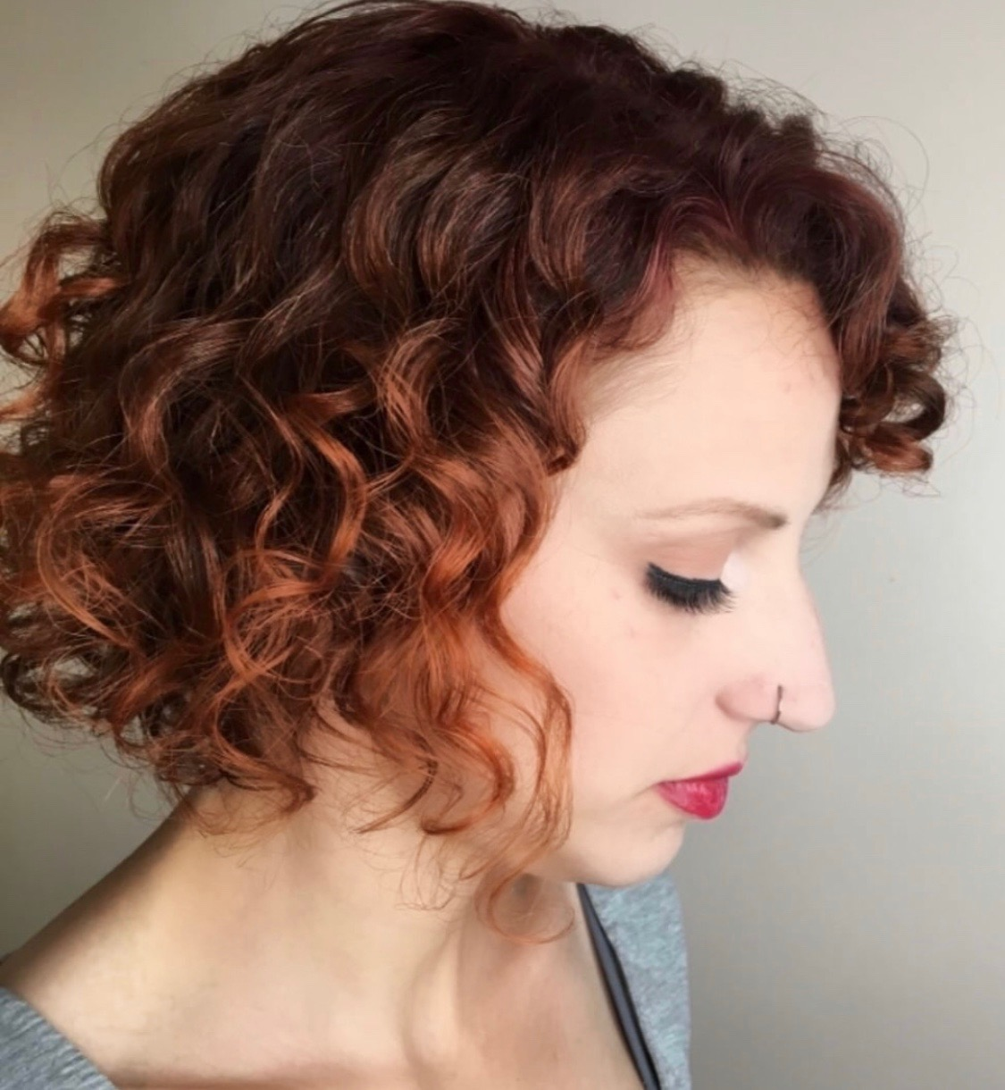 profile view woman with short curly hair