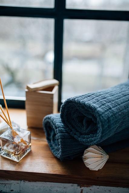 Rolled blue towels and incense burner
